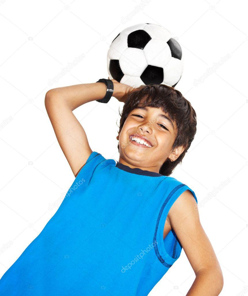 Cute boy playing football - Stock Image