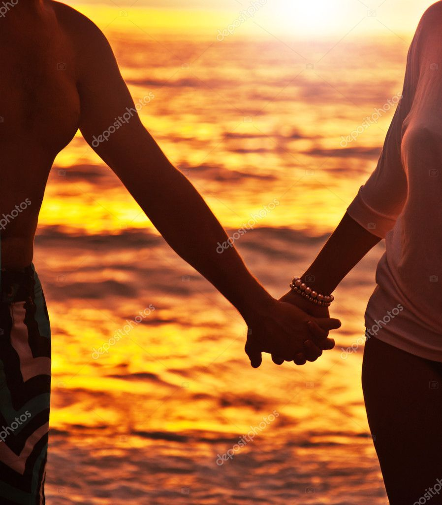 Couple holding hands running