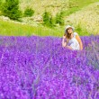 Beautiful woman on lavender meadow — Stock Photo