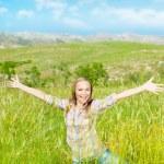 Happy cute girl on wheat field — Stock Photo
