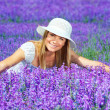 Pretty woman on lavender field — Stock Photo