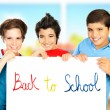 Three classmate boys playing in classroom — Stock Photo
