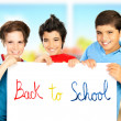 Three classmate boys playing in classroom — Stock Photo #12138562