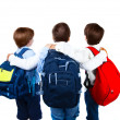 Stock Photo: Three schoolboys isolated on white background
