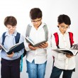 Stock Photo: Three smart boys read books
