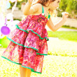 Nice small girl dancing outdoors — Stock Photo