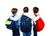 Tre skolpojkar isolerad på vit bakgrund — Stockfoto