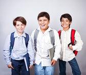 Three happy schoolboys — Stock Photo