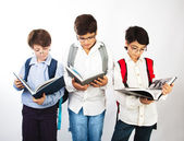 Three smart boys read books — Stock Photo