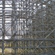Structure supports and wooden roller coaster — Stock Photo