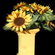 Foto Stock: Yellow vases made ​​of clay painted with flowers