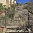 Stock Photo: Abandoned long stone staircase with iron