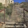 Abandoned long stone staircase with iron — Stock Photo