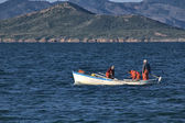 Fishermen fishing in the sea in a small boat — Stock Photo