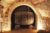 Old wine barrel in a cellar — Stock Photo