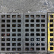 Grid in the floor of a drain — Stock Photo
