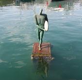 Bronze sculpture of a surfer — Stock Photo
