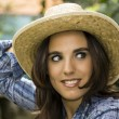 Pretty sexy woman face with a straw hat — Stock Photo #12244342