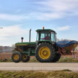 Traveling along a road tractor - Stock Photo