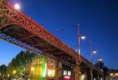 Night old bridge of iron oxidized with street lamps — Stock Photo