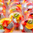 Colorful fruit salad in transparent glasses — Stock Photo