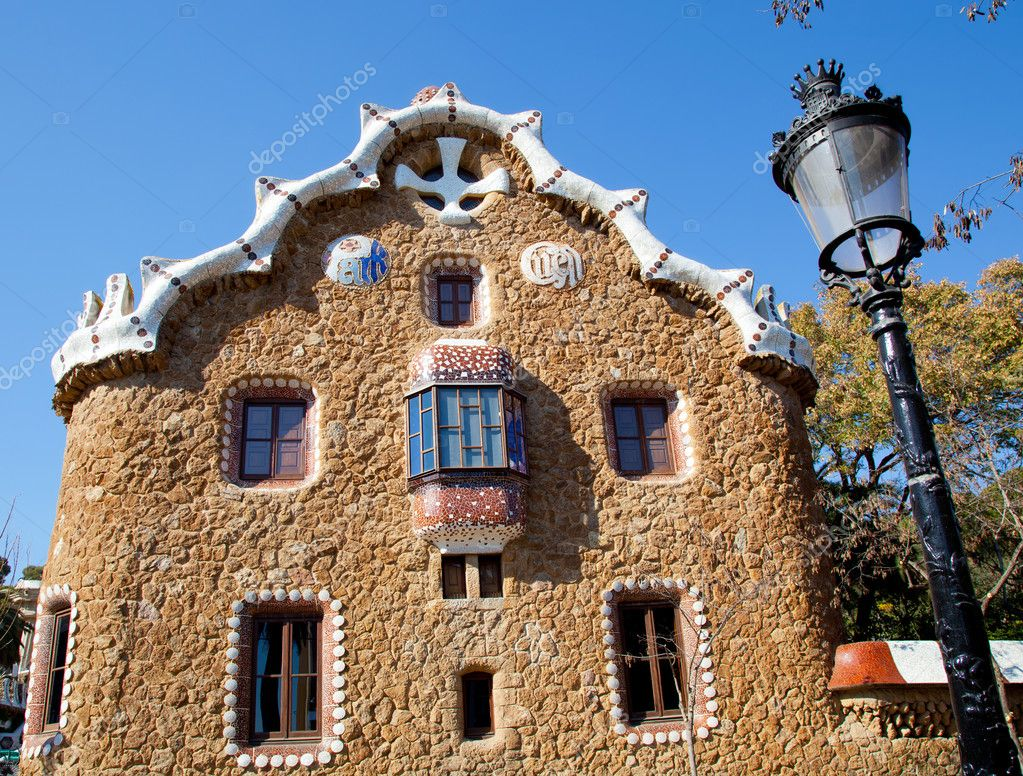 Barcelona park Guell fairy tale mosaic house on entrance — Stock Photo #10812863