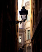 Barcelona gothic barrio streetlight backlight — Stock Photo