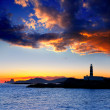 Ibiza island sunset Freus lighthouse and Es Vedra - Stock Photo