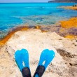 Balearic Formentera island with scuba diving fins - Stockfoto