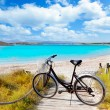 Bicycle in formentera beach on Balearic islands — Stockfoto