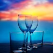 Dish of cups and crystal glasses on sea sunset — Stock Photo #11351324