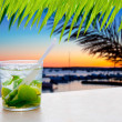 Cocktail Mojito in Balearic island sunset - Stock Photo