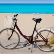 Bicycle in formentera beach on Balearic islands - Stockfoto