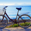 Bicycle in formentera beach with Ibiza sunset - Stock Photo