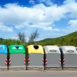Ecologic selective trash containers by colors - Stock Photo