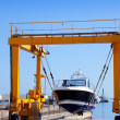 crane travelift lifting a boat on blue sky day — Stock Photo