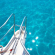 Balearic blue clean turquoise water from boat bow — Stock Photo