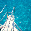 Balearic blue clean turquoise water from boat bow - Zdjęcie stockowe