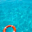 Buoy orange floating in perfect tropical beach — Stock Photo #11351724