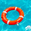 Buoy orange floating in perfect tropical beach — Stock Photo #11351733