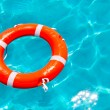 Buoy orange floating in perfect tropical beach — Stock Photo #11351740
