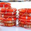 Buoys round lifesaver stacked for boat safety — Stock Photo