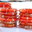 Buoys round lifesaver stacked for boat safety - Stock Photo