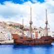 Eivissibiztown with old classic wooden boat — Stock Photo #11358669