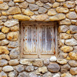 Masonry stone wall with grunge wood window — Stock Photo #11358754