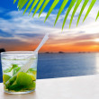 Ibiza cala Conta Conmte sunset with Mojito drink - Stock Photo
