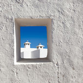 Balearic islands white chimney through window — Stock Photo