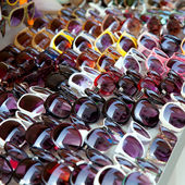 Fashion sunglasses rows in outdoor shop display — Stock Photo