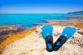 Balearic Formentera island with scuba diving fins — Stock Photo