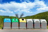 Ecologic selective trash containers by colors — Stock Photo